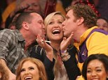 Cheeky: Will Ferrell (right) stole a kiss from an apparent couple at the Los Angeles Lakers game on Thursday night