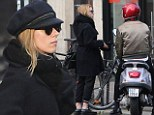 Scarlett Johansson covers up her baby bump with heavy coat as she emerges for first time since 'pregnancy' was revealed