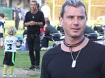 Giving Gwen time to rest: Gavin Rossdale takes his boys Kingston and Zuma to a flag football game after welcoming third son Apollo