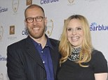 Expecting again! Rosie Pope and her husband Daron pictured in March last year before the birth of their daughter Vivienne
