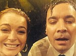 Not their best looks: Lindsay and Jimmy weren't afraid to pose for the camera once they were dripping wet