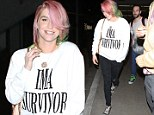 Making a statement: 'I'm a survivor' was printed loud and bold on Kesha's sweater as she landed at LAX on Thursday - following a month long stint in rehab earlier this year