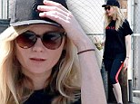 Kirsten Dunst sips on healthy green drink and shows off toned legs in spandex at the gym ... the day after partying the night away
