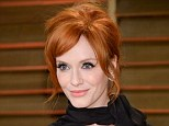 Flame-haired siren: Christina Hendricks, pictured here at last weeks Oscars, shares her beauty tips in the April edition of Redbook and reveals she is actually a natural blonde