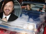 "Lauren Parsekian and Star Aaron Paul attend the US Premiere of DreamWorks Pictures ""Need For Speed"" at The TCL Chinese Theatre in Los Angeles,"