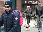 Playful in pink! Hugh Jackman taps into his inner child by wearing a bright backpack during family outing