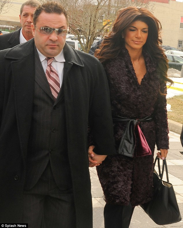 Support: The couple held hands as they arrived at the Federal Court in Newark and did not speak to reporters