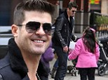 Happy birthday! Robin Thicke received an early birthday gift from a young fan while out in New York City on Friday