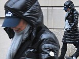 Not giving anything away! Scarlett Johansson keeps covered up in a thick coat amid pregnancy rumours