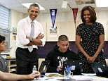U.S. President Barack Obama and first lady Michelle Obama meet with students at the Coral Reef High School in Miami, Florida, March 7, 2014. REUTERS/Yuri Gripas