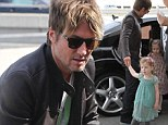 Doting dad Keith Urban escorts his darling daughters Faith & Sunday from their limo at LAX