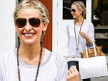 Maybe money CAN buy happiness! Sarah Michelle Gellar beams on a shopping trip as she is set to make nearly $2M profit after putting estate on market