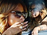 What is she smoking? Christina Milian puffs on something that doesn't look like a regular cigarette