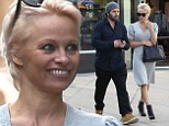Pamela Anderson continues her stylish streak in chic dress and leather booties as she grabs lunch with husband Rick Salomon
