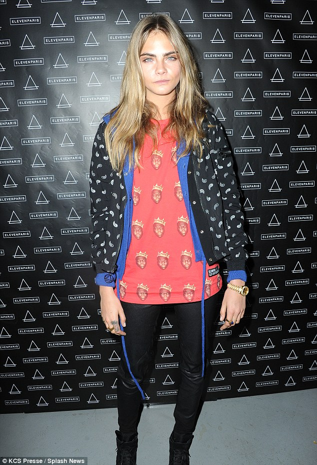 Star appeal: Cara was in good company at the event as Kate Moss was also in attendance