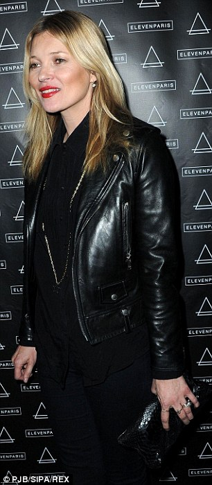 Model behaviour: Kate opted for an all-black ensemble for the evening with a black top and leather jacket
