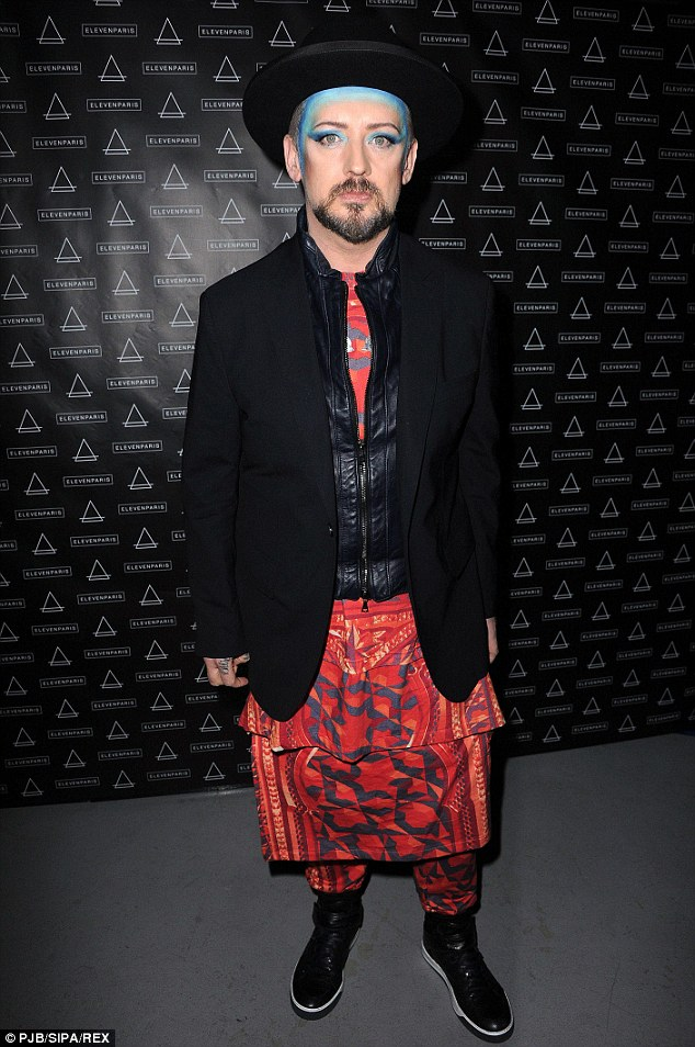 Hat's off to him: Boy George also attended the party and, like Kate, opted for a leather jacket, while he also sported a fetching orange and black patterned outfit
