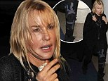 Brace yourself! Daryl Hannah jets through the airport in all black while wearing knee support