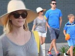Blocking out the sun: Reese Witherspoon donned a wide brimmed straw hat while out with her talent agent husband Jim Toth and ten-year-old son Deacon Phillippe in Los Angeles on Saturday