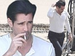 Up in smoke! Colin Farrell puffs on a cigarette while on the set of a beach photo shoot