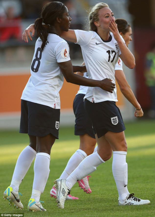 Toni Duggan (centre) celebrates goal with Anita Asante (left) during the UEFA Women's EURO 2013 match between England and Russia