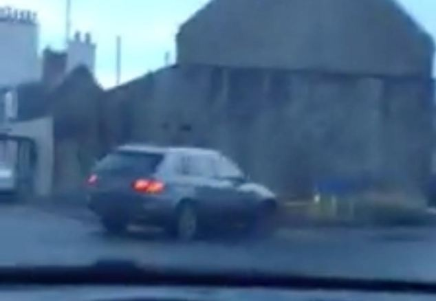 Footage taken by another motorist shows Hills veering across the Aberdeen to Dundee road in his BMW 4x4