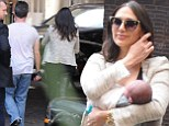 One content mum! Lauren Silverman cuddles baby Eric in her arms as she steps out in London with Simon Cowell