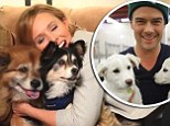 Aww! Bell and Duhamel posed with pooches