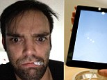 The 'thief,' seen here, allegedly took a selfie with the stolen iPad