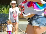 Ready to pop: Patacky held onto her daughter's hand with her bulging belly