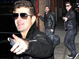 Robin Thicke ditches the wedding ring and ceases all public declarations of love as he admits marriage to Paula Patton is over