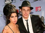 Happier times: Blake Fielder-Civil and Amy Winehouse in July 2007, a few months after they got married