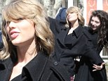 Girls just wanna have fun! Taylor Swift and Lorde hammed it up for photographers as they went sightseeing in New York City