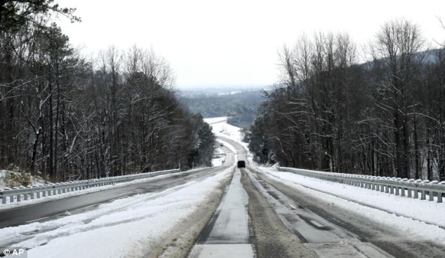 Desolate: Few cars passed on state highway 31 in Vinemont, Alabama on on Tuesday as another winter storm bore down on the south. It is expected to bring icy rain and several inches of snow