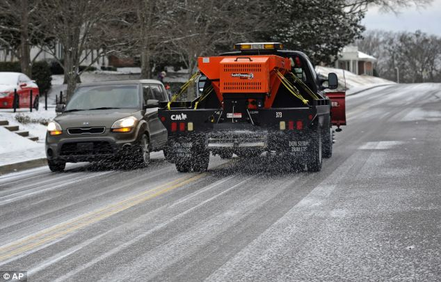 Protection: A University of Mississippi truck sprays salt on a road on the campus in Oxford, Mississippi