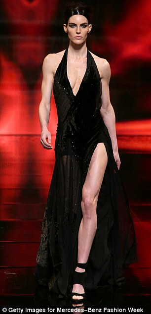 Lady in red: Models - including Karlie Kloss (l) looked absolutely flawless as they strutted down the runway