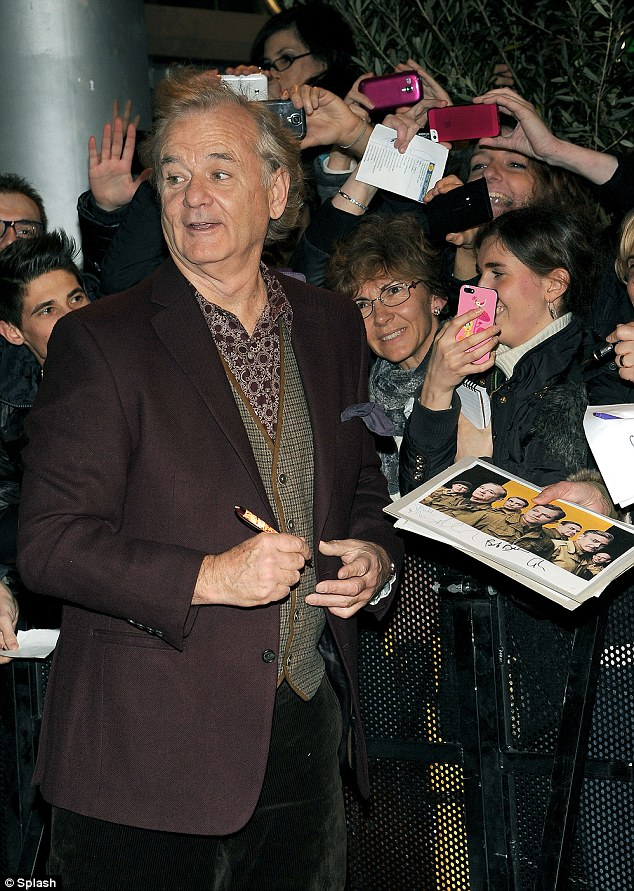 Still popular: Bill was mobbed by excited fans as he gamely signed autographs