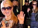 Blonde ambition! Paris Hilton arrives in Philippines amid heavy security to open her sprawling apartment complex project