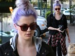 New hair, new 'do: Ireland Baldwin styled her purple locks into a messy updo to step out in Los Angeles, California on Friday