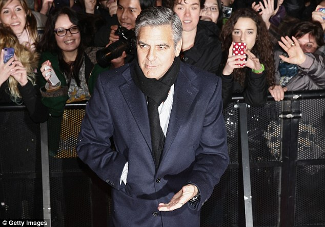 Big star: The fans went wild for the 52-year-old as they eagerly snapped pictured of George while he posed on the red carpet
