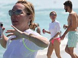 Wet T-shirt contest? Marysol Patton hits Miami Beach braless in a see-through white top with mystery man in tow