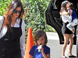 Hot momma! Kourtney Kardashian showed off her toned legs as she took her son Mason out to SkyHigh in Woodland Hills, California on Sunday