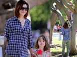 Get me down from here! Alyson Hannigan's daughter Satyana is stuck in a tree while proud mom snaps away on her camera