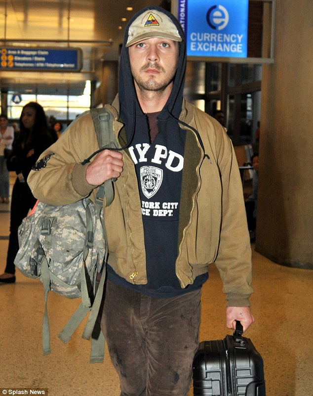Quiet star: Arriving into LAX airport on Monday Shia didn¿t say a word to anyone, preferring to simply walk to his waiting car and be driven off into the distance