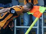 Heading to Wembley: David Meyler celebrates his goal by headbutting the corner-flag one week on from the controversy in which Newcastle manager Alan Pardew put his forehead in the player's face