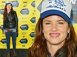 Keep on truckin'! Juliette Lewis goes grunge in a beer hat to promote her new movie at SXSW