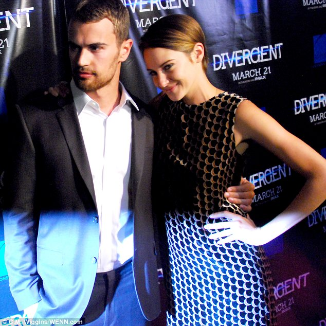 Co-stars: Shailene cuddled up to her hunky co-star and on-screen love interest Theo James at the premiere