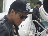 Runway Baby! Bruno Mars disembarks his private jet as he arrives in Sydney for sell out shows after cancelling Brisbane gig