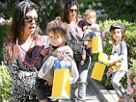 Mother of two: Kourtney Kardashian escorted her children Mason and Penelope to a birthday party on Saturday in Beverly Hills, California