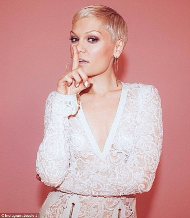 Calling All Hearts: The hitmaker also shared a snap as she posed in a racy white lace dress taken from her latest video with Robin Thicke and DJ Cassidy